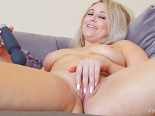 Solo blonde MILF model Elle masturbates with a vibrator