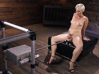 Short haired blonde MILF slut Helena Locke ill-treated by machines