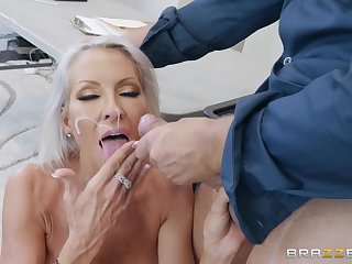 Seductive blonde MILF Emma Starr sprayed with cum surpassing face by a cop