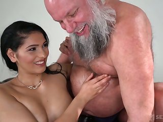 Buxom and sexy knockout Ava Black rides older man's strong cock on top