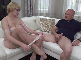 Blonde mature nerdy MILF Rina M. blows and rides an older suppliant