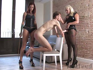 Two mistresses in latex outfits trouble strapon with the addition of quell one submissive dude