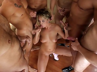 Horny wife makes out of doors with a bunch of men in dirty party bang