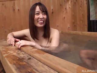 Cute Japanese beau smiles while riding a cock of her darling