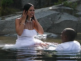 Bride gets busy with the BBC while all round the water